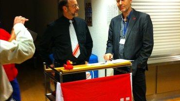 Foto von Hans E. Knab und Michael Blug im Dialog beim Neujahrsempfang zum Thema Energiepolitik in der BNetzA Mainz